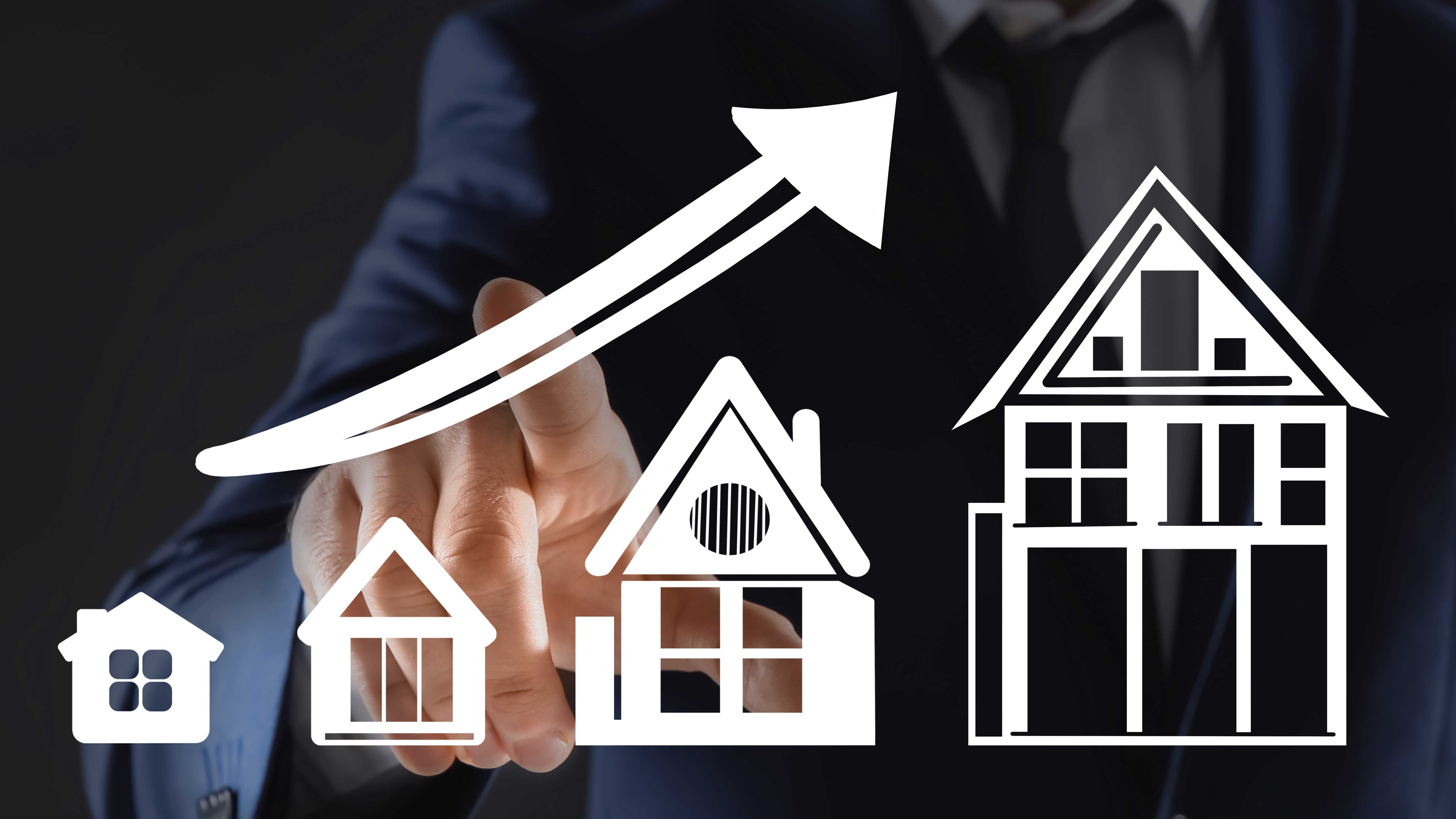 AltText: Häuser werden aufsteigend größer.